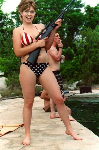 Palin in a bikini holding weapon of mass destruction.